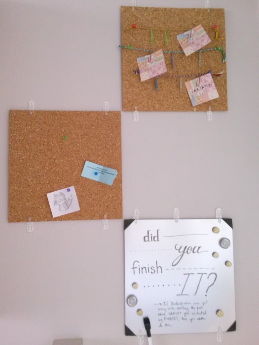 Two corkboards and a dry erase board for organization